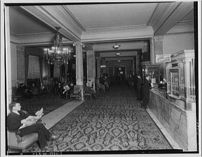 Lobby of Raleigh Hotel with man reading newspaper in foreground