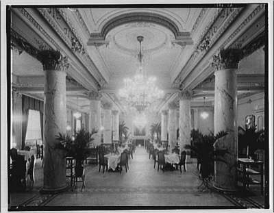 Dining area in Raleigh Hotel, with columns and chandelier
